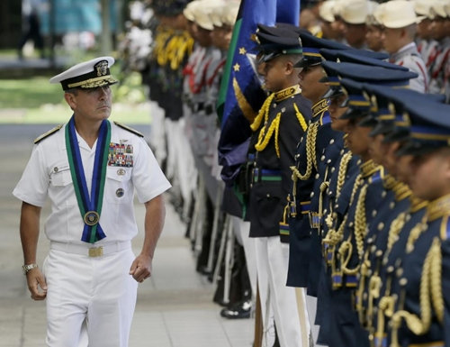 """u.s. navy admiral harry b harris, united states pacific command to the philippines commander (uspacom), reviews the troops during welcoming ceremony at the armed forces headquarters at suburban quezon city northeast of manila, philippines wednesday, aug. 26, 2015. in the armed forces of the philippines press statement, admiral harris is here for a two-day visit """"to discuss bilateral security concerns with the philippines and gain local perspective on the security situation in the area of the pacific region where the philippines is located."""" (ap photo/bullit marquez)"""