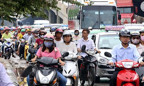 Dừng thu phí bảo trì đường bộ với xe máy từ 2016